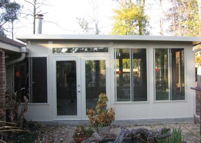 3 inch glass room with horizontal sliders 18 inch kick plate double door above roof line with super gutter insulated patio cover
